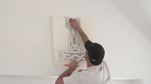 Align the large wall sticker as a trial