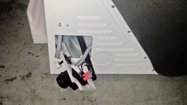 Tumble dryer with rear maintenance hatch